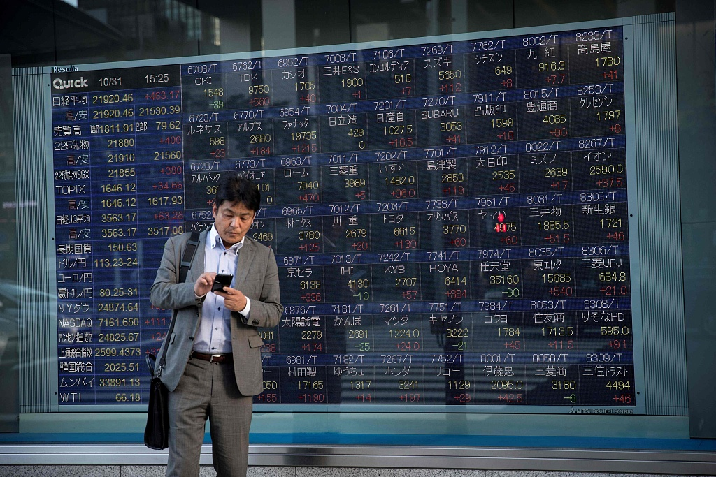 Tokyo stocks close lower on concerns over new virus lockdowns in Europe