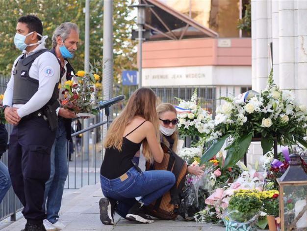 People pay tribute to victims of knife attack in Nice, France