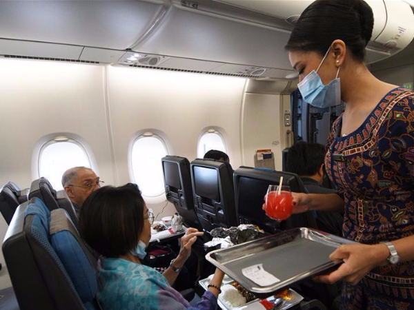 Singapore residents savor airline cuisine to appease appetite for air travels