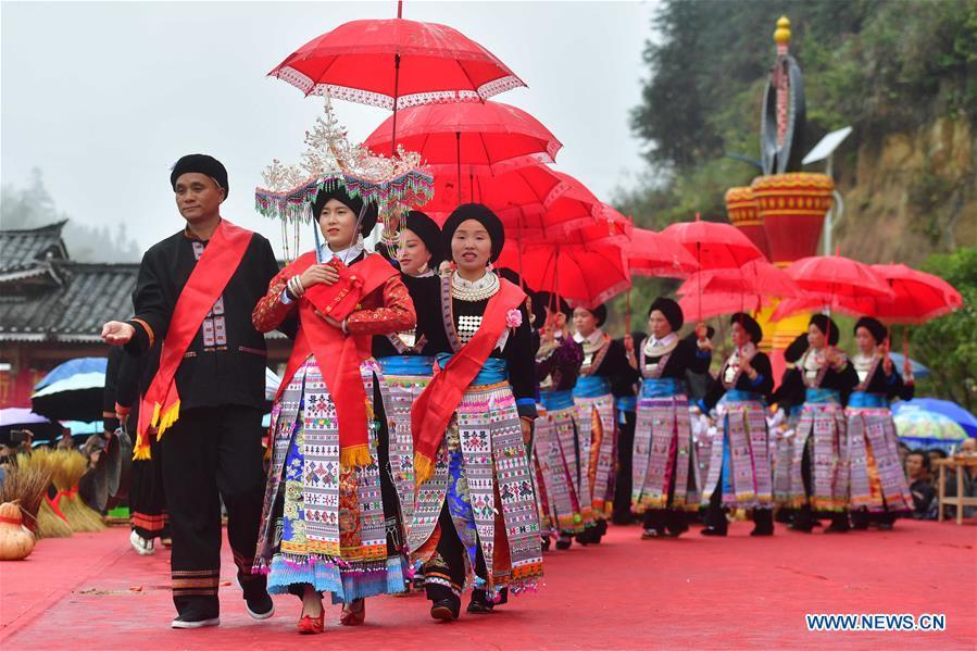 People of Yao ethnic group perform during harvest festival in Guangxi