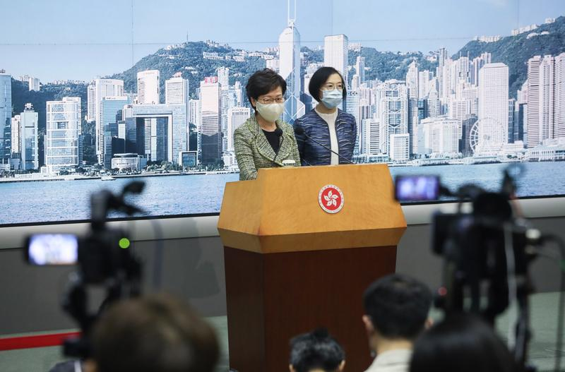 HK virus curbs to stay, contact tracing app soon