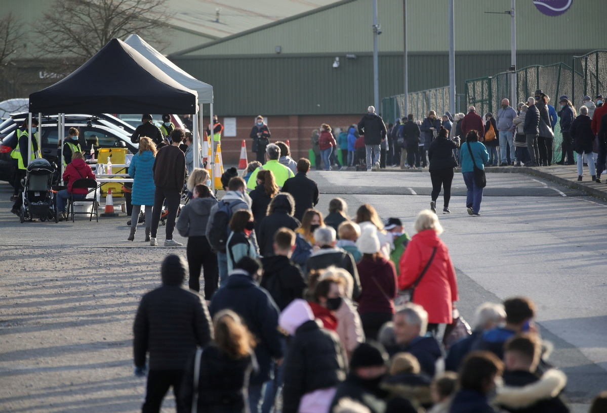 Liverpool residents queue to be tested as UK's first mass COVID-19 testing starts