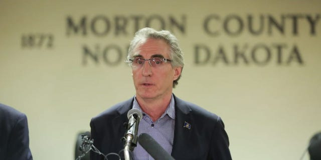 ND governor says asymptomatic health care workers with COVID-19 should be able to continue working