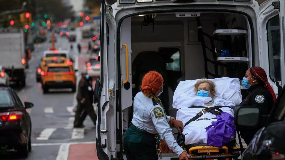 New York closes bars to head off virus resurgence as WHO warns of vaccine distrust