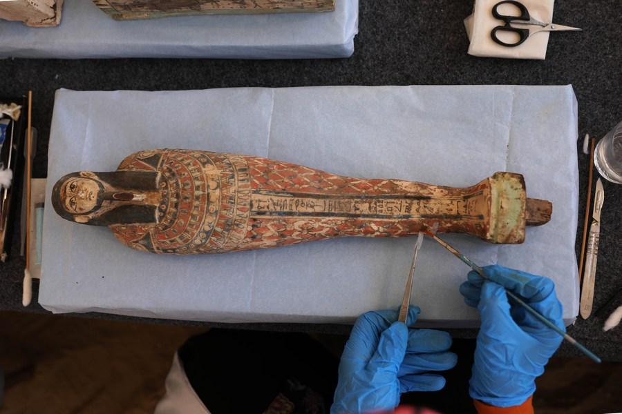 Egypt unveils 100 ancient wooden coffins