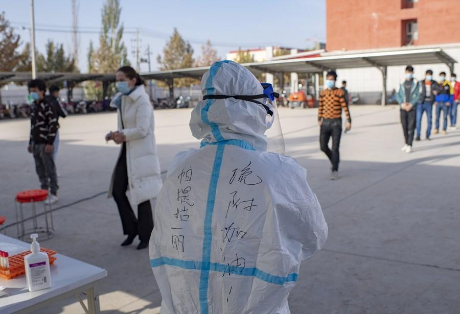 China's Xinjiang reports no new COVID-19 cases for 9 days