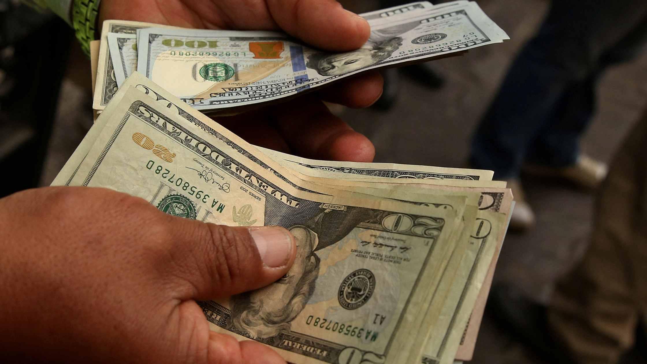 US dollar dips amid vaccine news