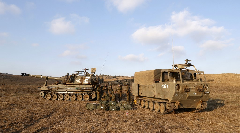 Israel air strikes in Syria kill three troops, hit Iranian targets