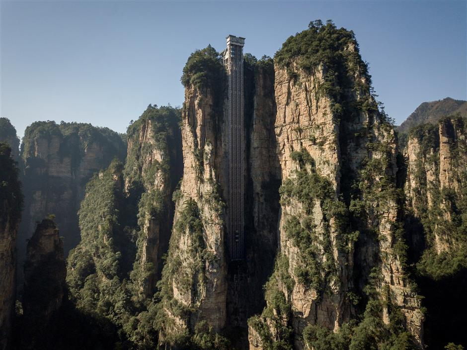 Towering outdoor lift zips tourists up China's 'Avatar' cliff