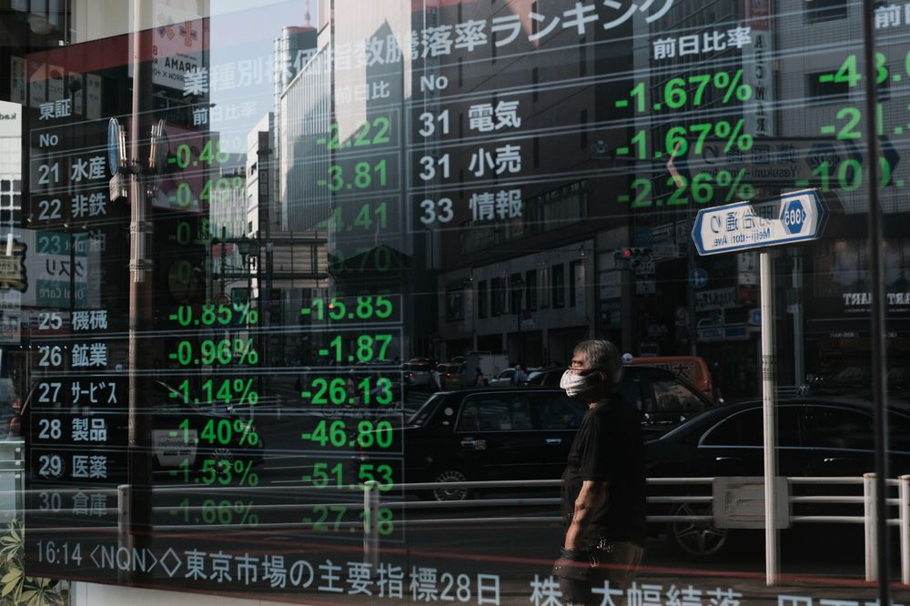 Tokyo stocks end mixed on worries over economic fallout from COVID-19