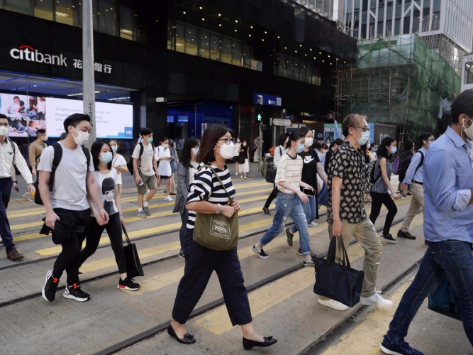 HK tightens social distancing measures on surging COVID-19 cases