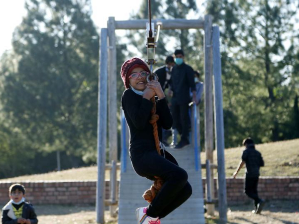 Children have fun at park on World Children's Day in Islamabad, Pakistan
