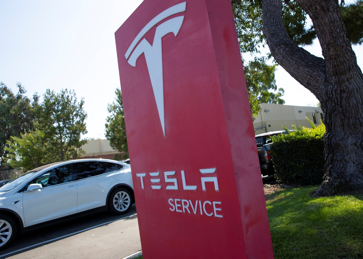 Tesla plans to produce electric car chargers in China, document shows