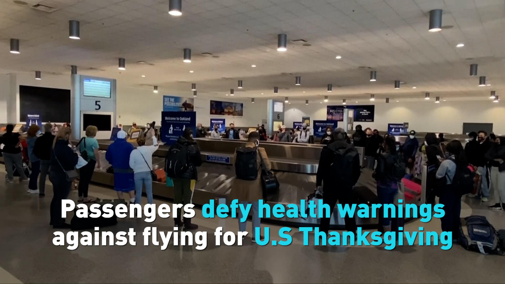 Passengers defy health warnings against flying for US Thanksgiving
