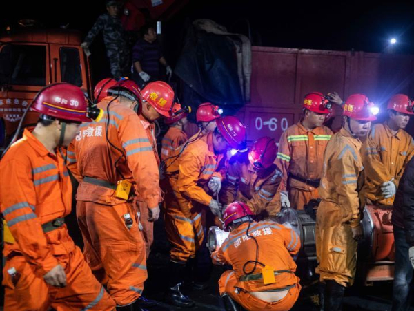 Rescue underway for 13 trapped coal miners in central China