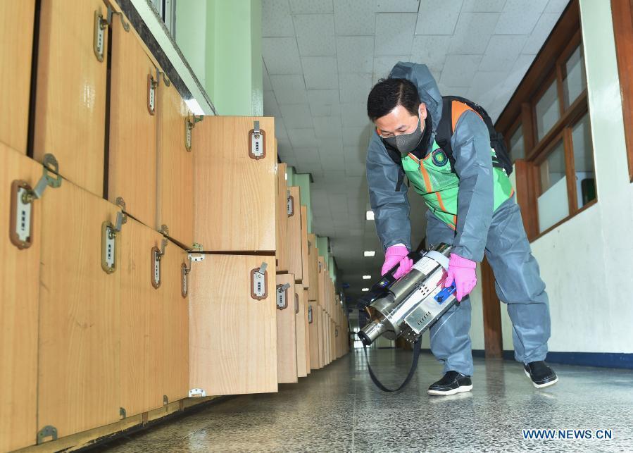 Staff members sterilize facilities at high school in Seongnam City, South Korea