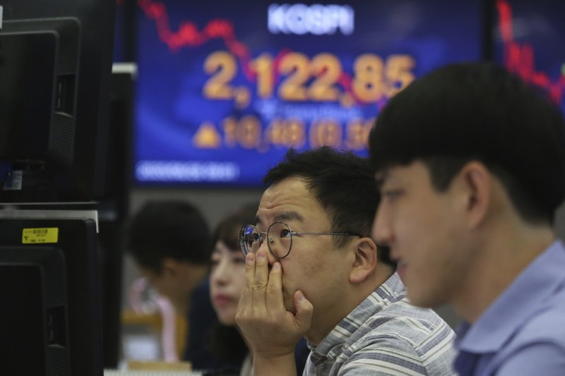 Asian markets mostly up on vaccines, eyes on US stimulus talks