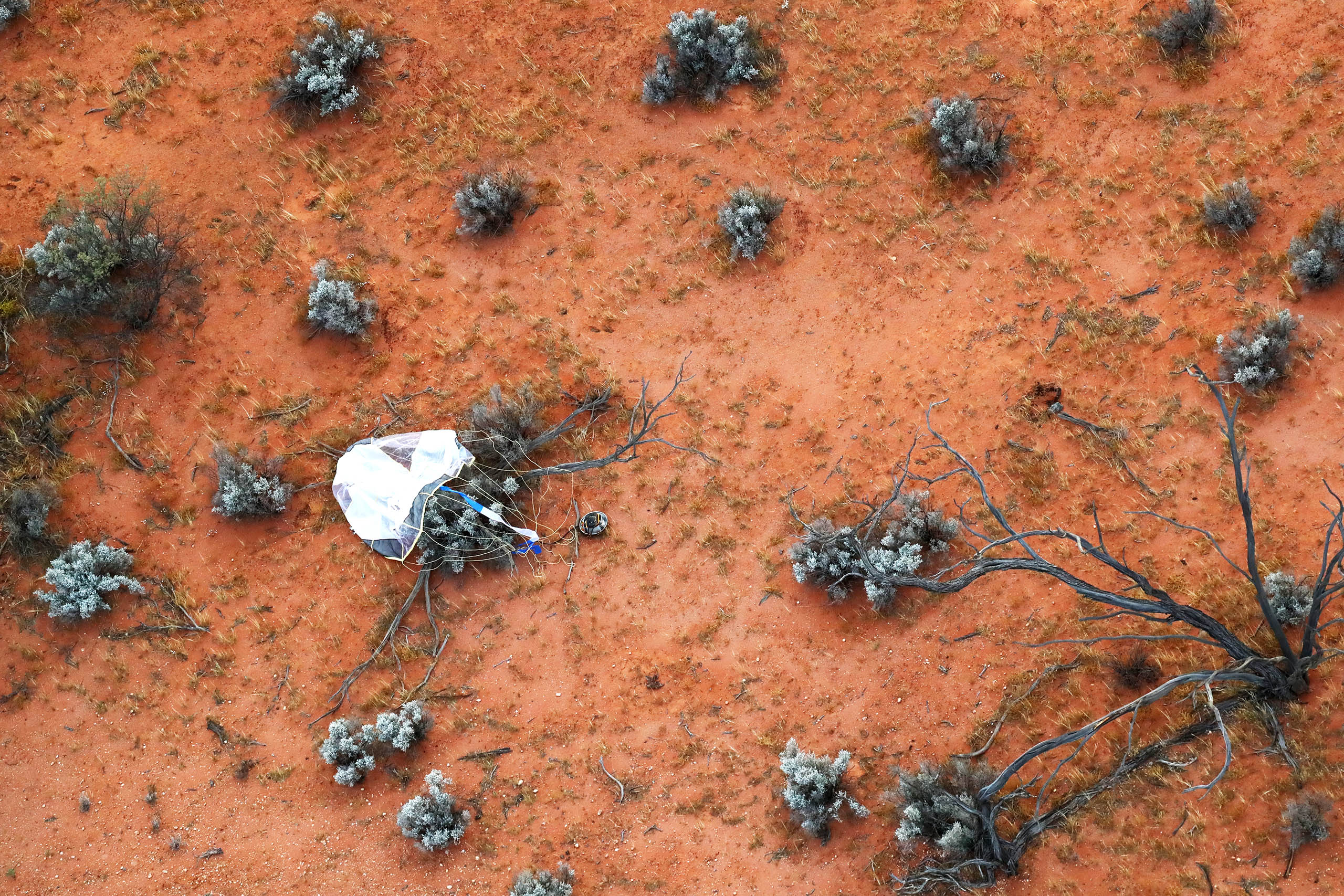 Japanese space capsule carrying asteroid rocks lands in Australian outback