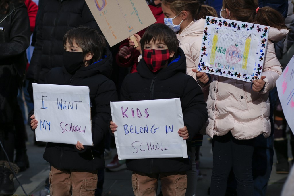 Citing low virus rates in schools, NYC again reopens schools