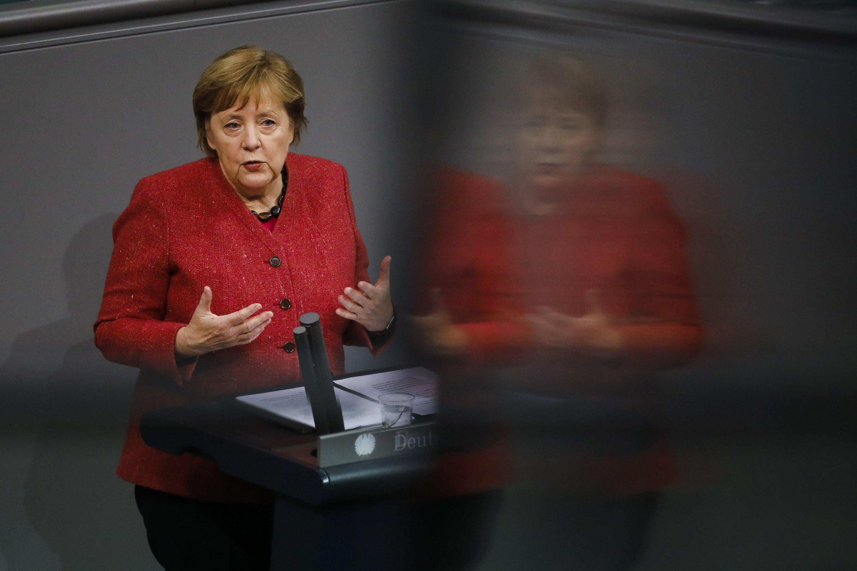 Merkel backs tougher virus curbs as German deaths hit record
