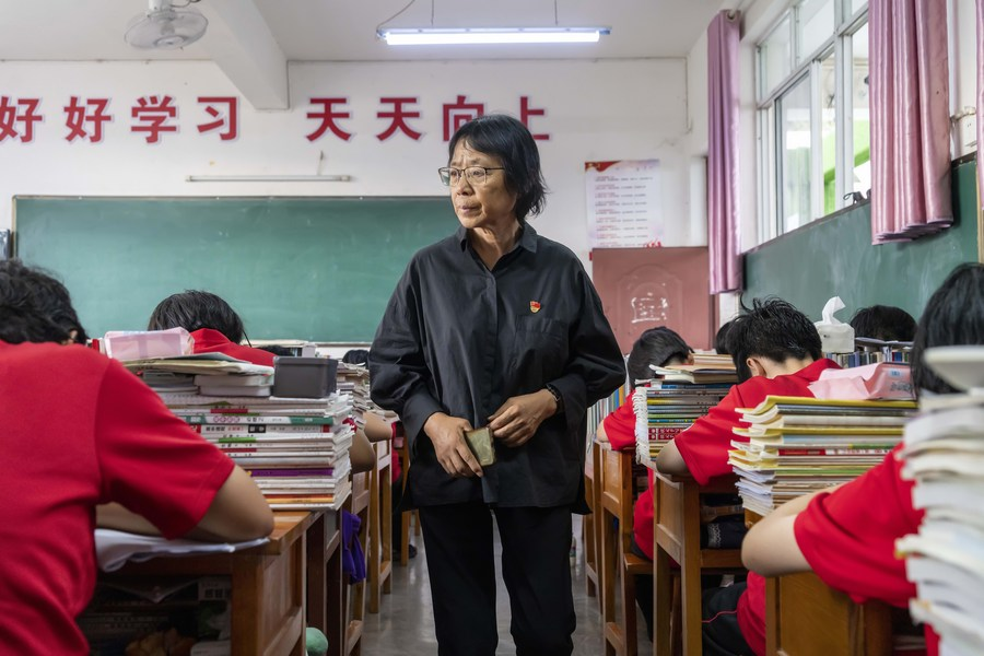 China honors school principal for dedication to education for girls