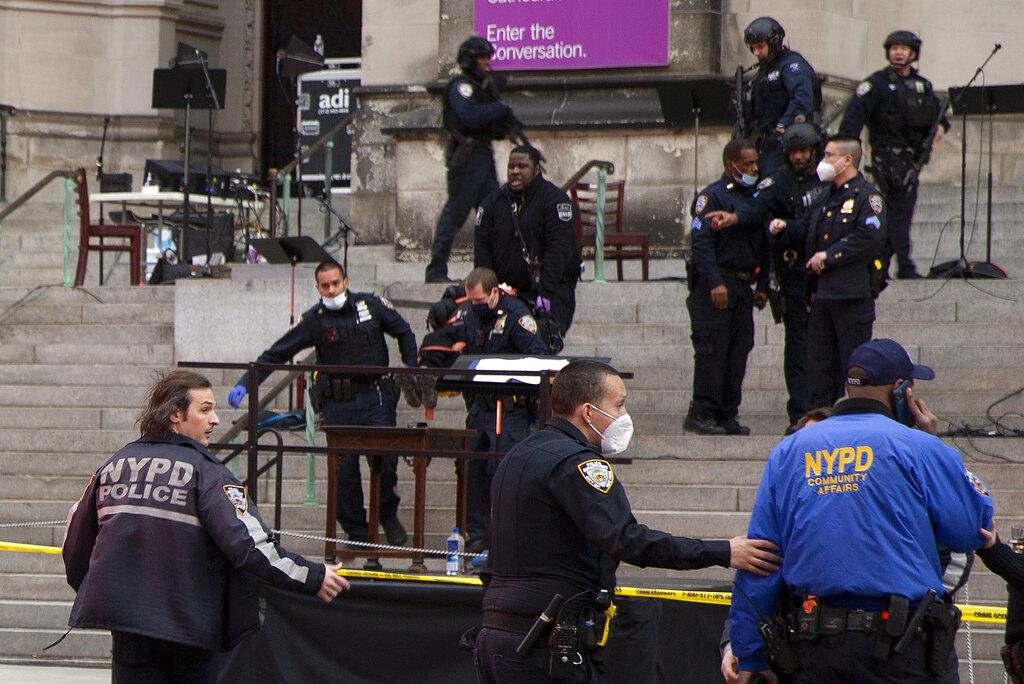 Gunman shot by police at NYC cathedral Christmas concert