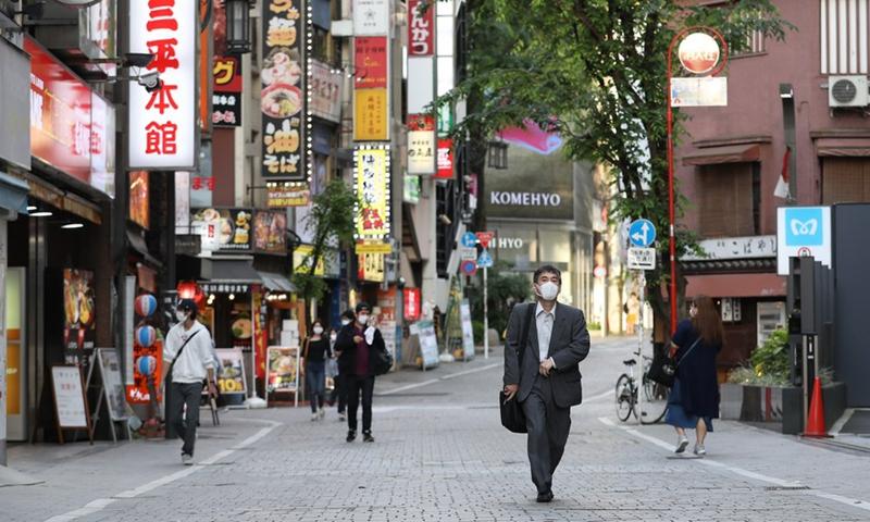 Tokyo stocks close higher as BOJ survey shows business sentiment improving