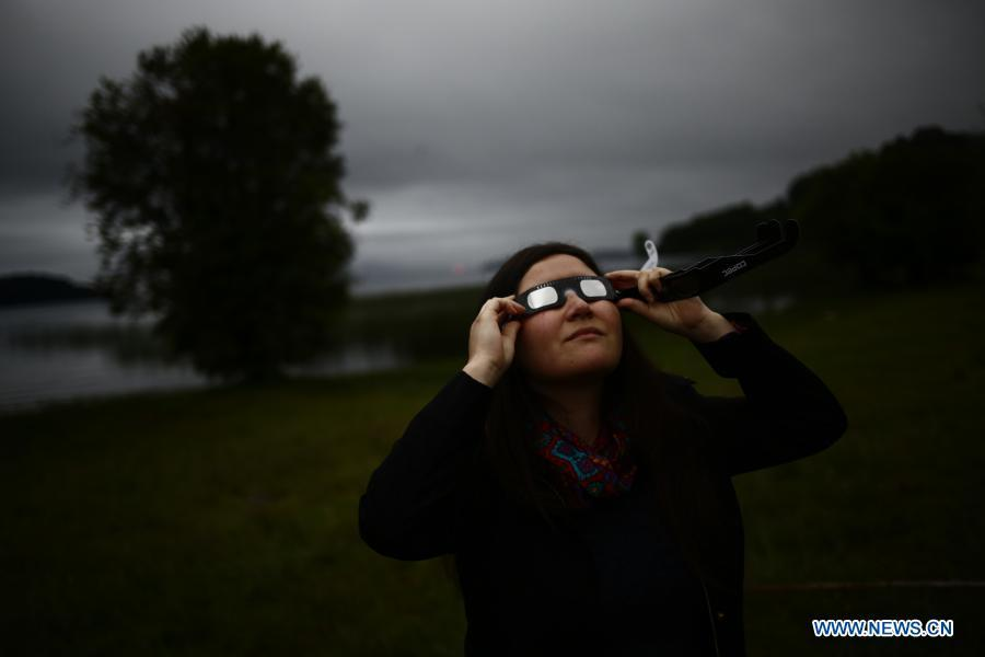 People observe total solar eclipse in Chile
