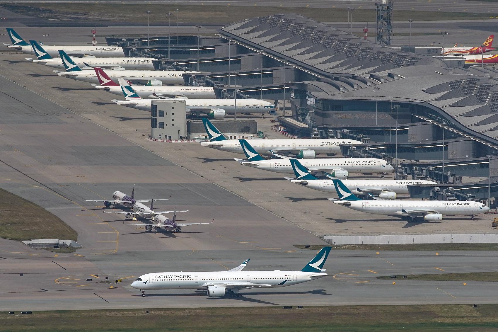 Hong Kong to suspend flights from UK over new coronavirus strain
