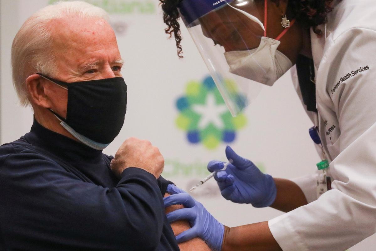 Biden gets coronavirus vaccine as US inoculation effort mounts