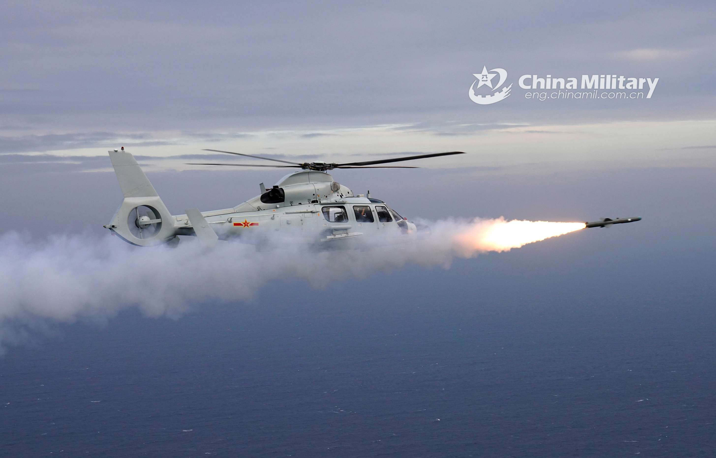 Ship-borne helicopters fire missiles