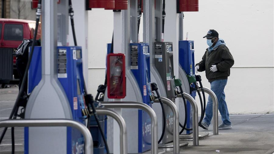 Oil prices gain amid drop in US inventories