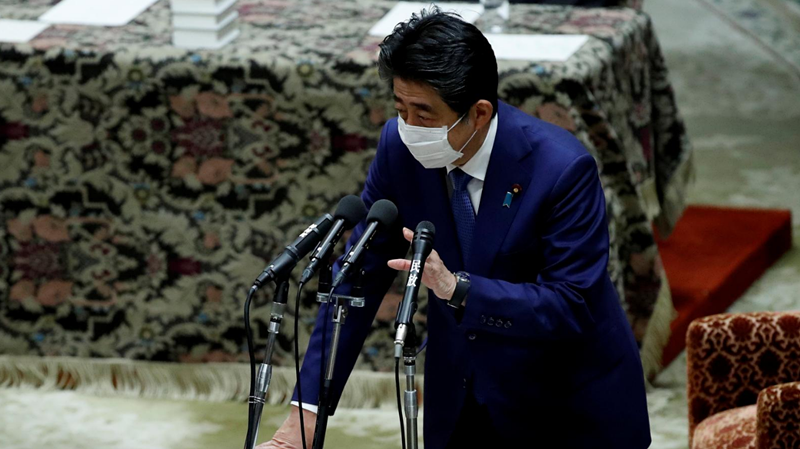 Ex-Japan PM Abe apologizes and corrects parliament statements over funding scandal