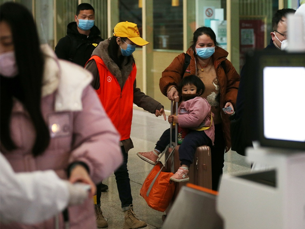 China urges reduced holiday travel and gatherings amid mounting pressure of COVID-19 resurgence
