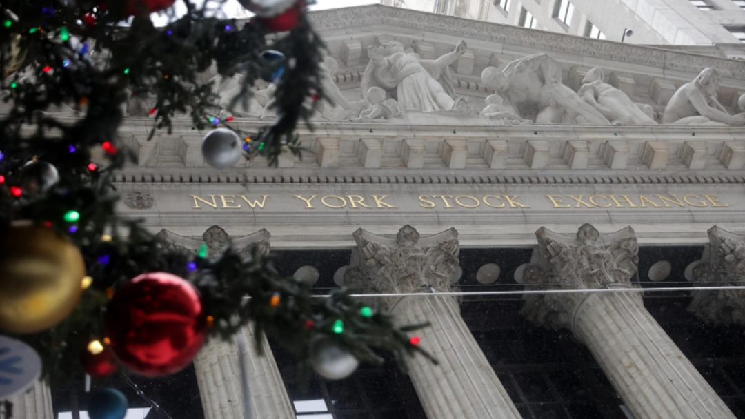 Wall St dips from record levels, additional stimulus uncertain
