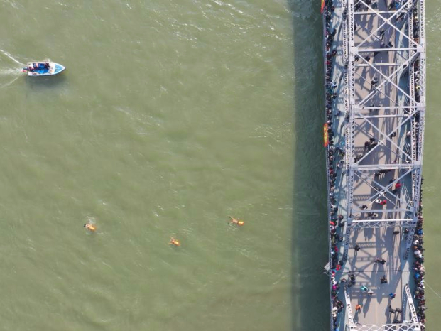 China's Lanzhou holds winter swimming event in Yellow River