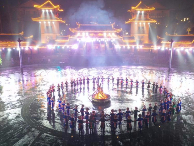 People dance to greet advent of New Year in Ameiqituo Town, Guizhou