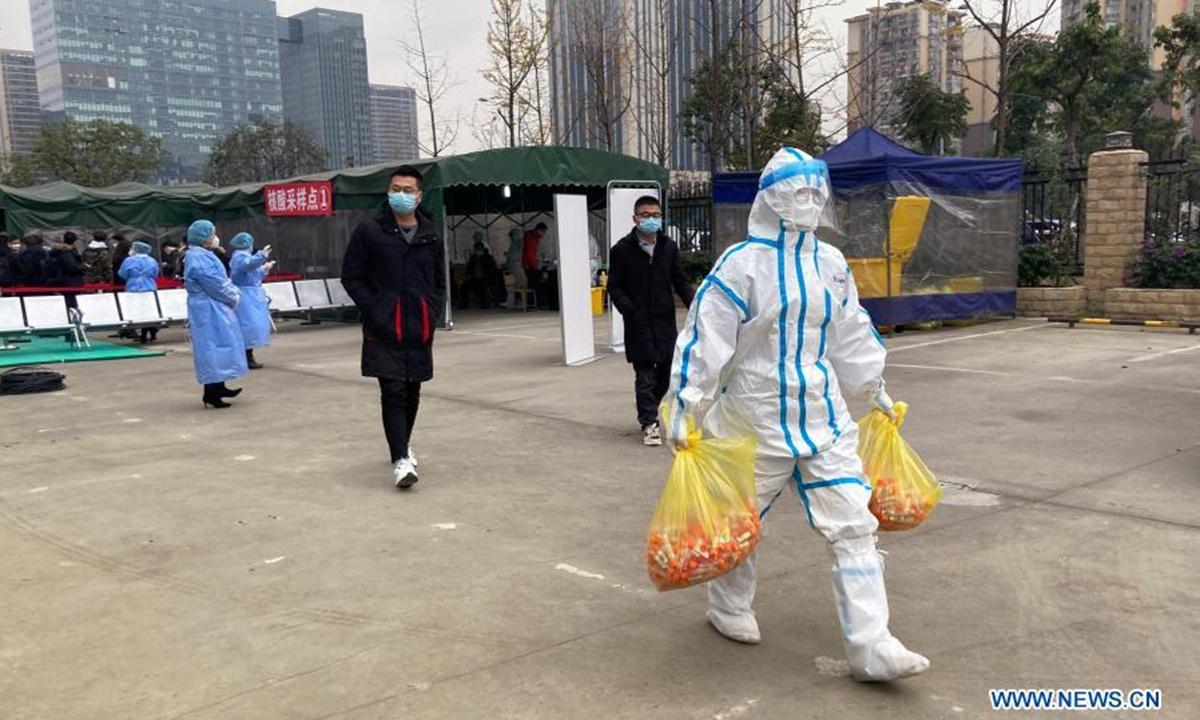 Beijing brings latest outbreak 'under control,' ups risk prevention at suburban village