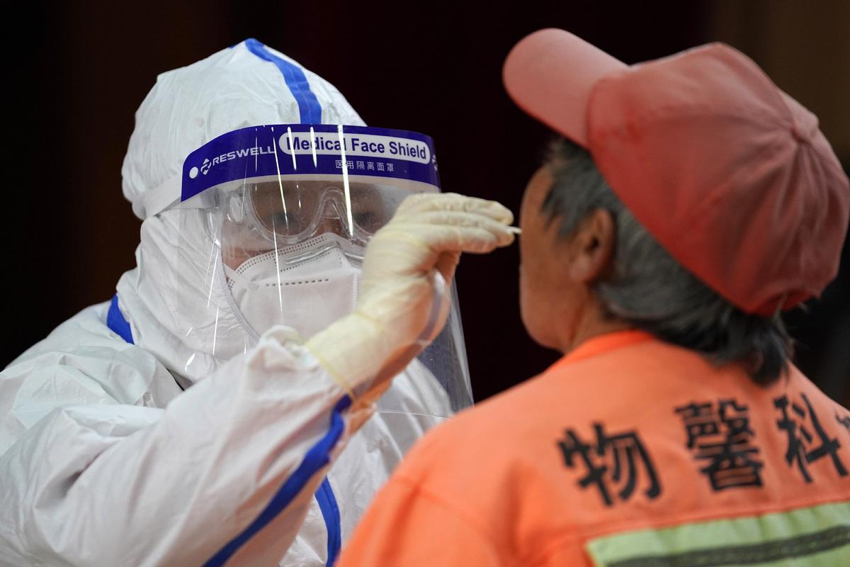 China balances virus control and economy, people: WSJ