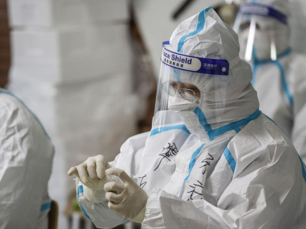 Medical workers collect nucleic acid test samples from residents in Shenyang, NE China