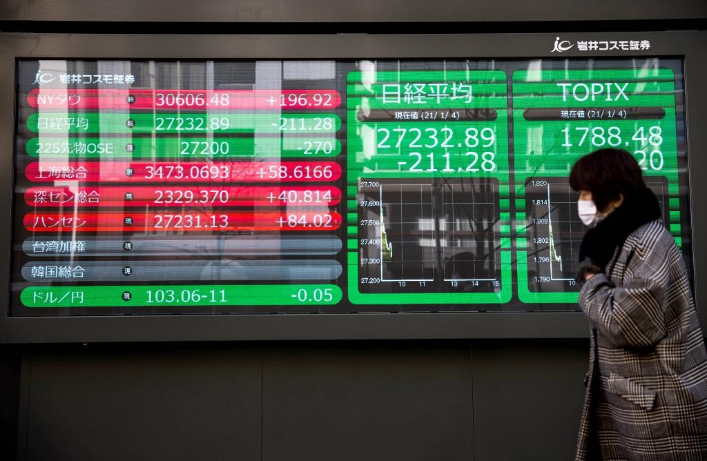 Tokyo stocks open lower amid caution ahead of virus emergency