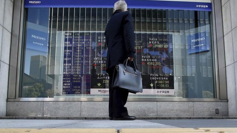 Tokyo shares open lower ahead of state of emergency