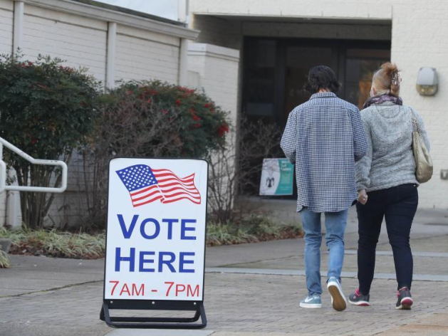 Voters cast ballots in southeastern state of Georgia for US Senate candidates
