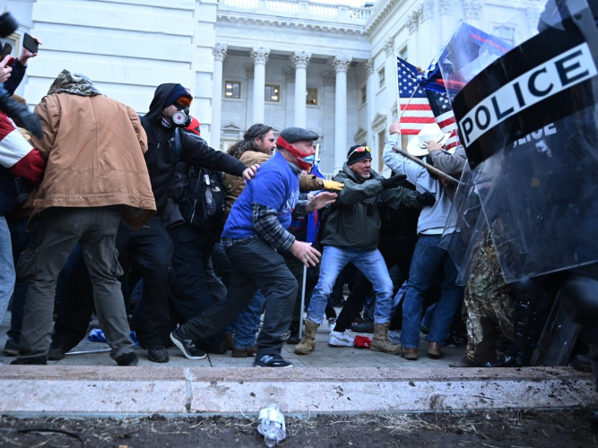 Woman shot in US Capitol unrest dies: police
