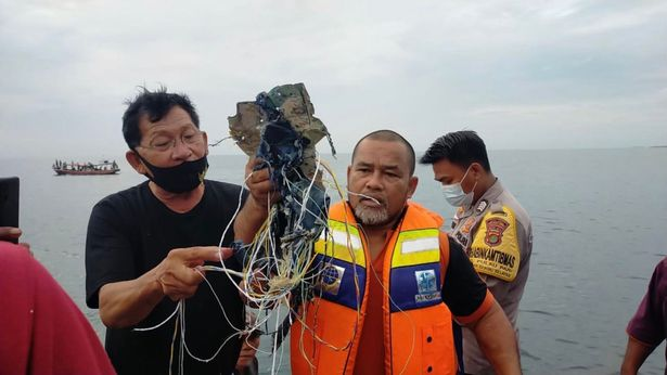 Body parts found at Indonesian plane crash site: official