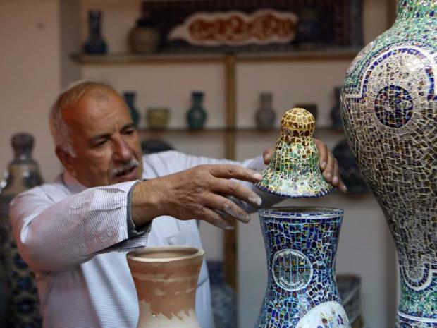 Palestinian artist creates artworks from damaged ceramics