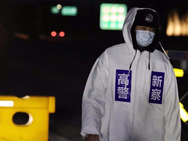 Police officers stand on duty at temporary checkpoint for epidemic control in Hebei, N China