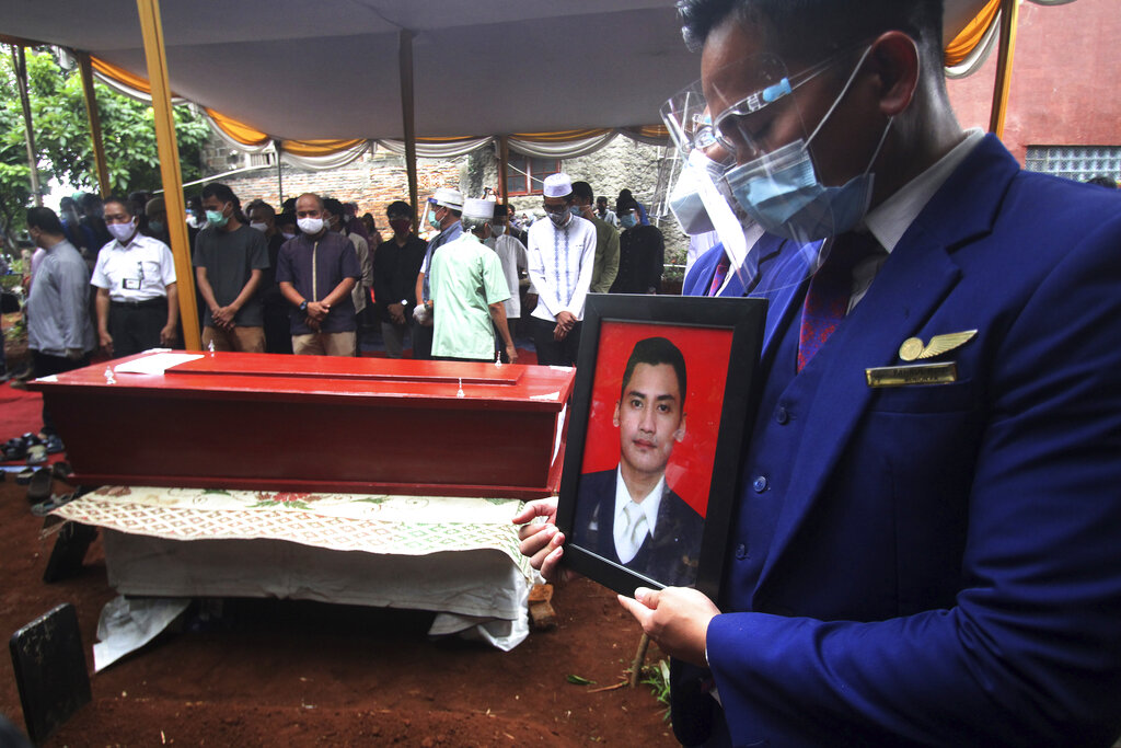 Search expands for victims of Indonesian plane crash