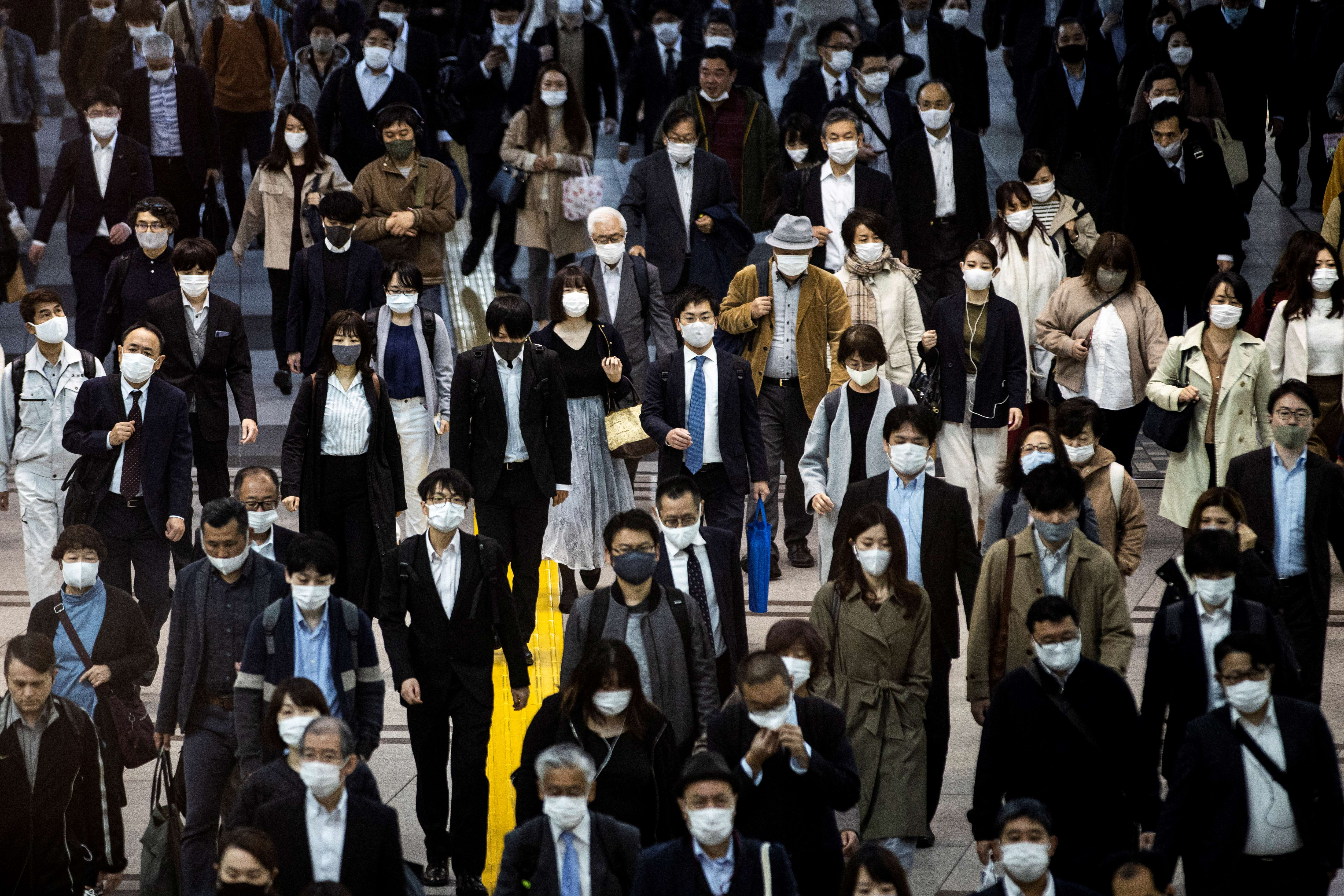 Japanese experts suggest stronger measures needed to combat virus surge