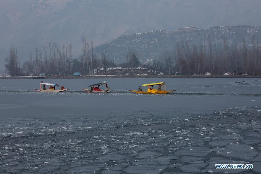 In pics: frozen Dal lake in Srinagar, Indian-controlled Kashmir